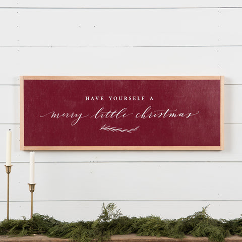 "red wooden wall sign that says ""have yourself a merry little christmas"""