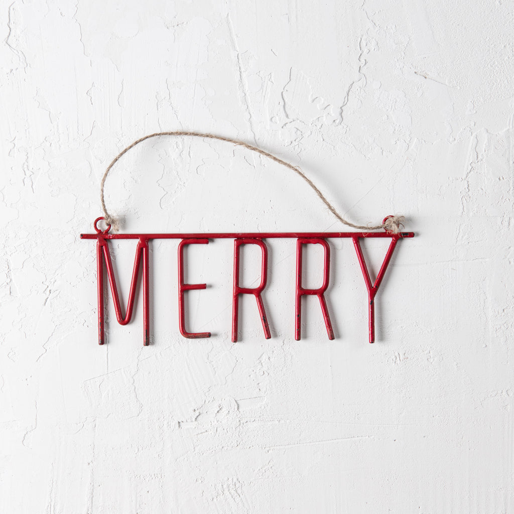 "red metal ornament of the word ""MERRY"""