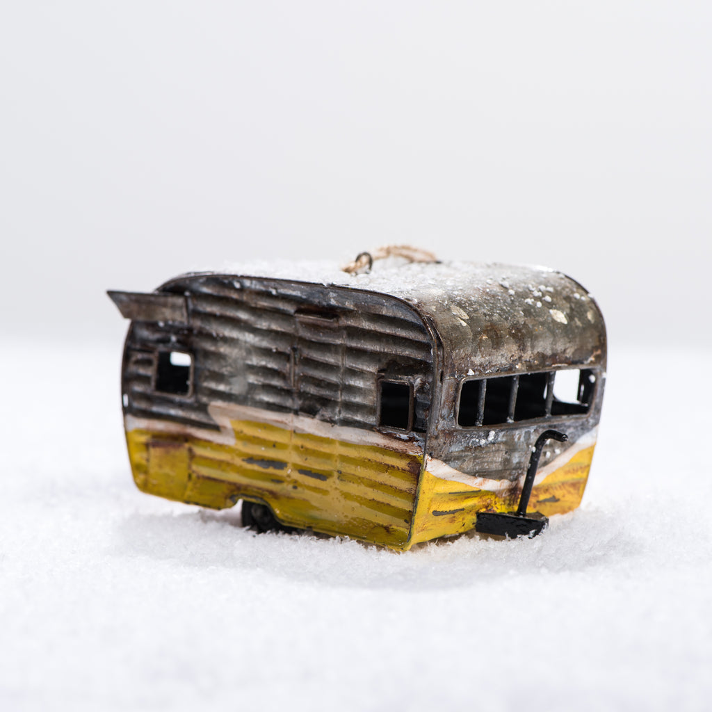yellow metal camper ornament