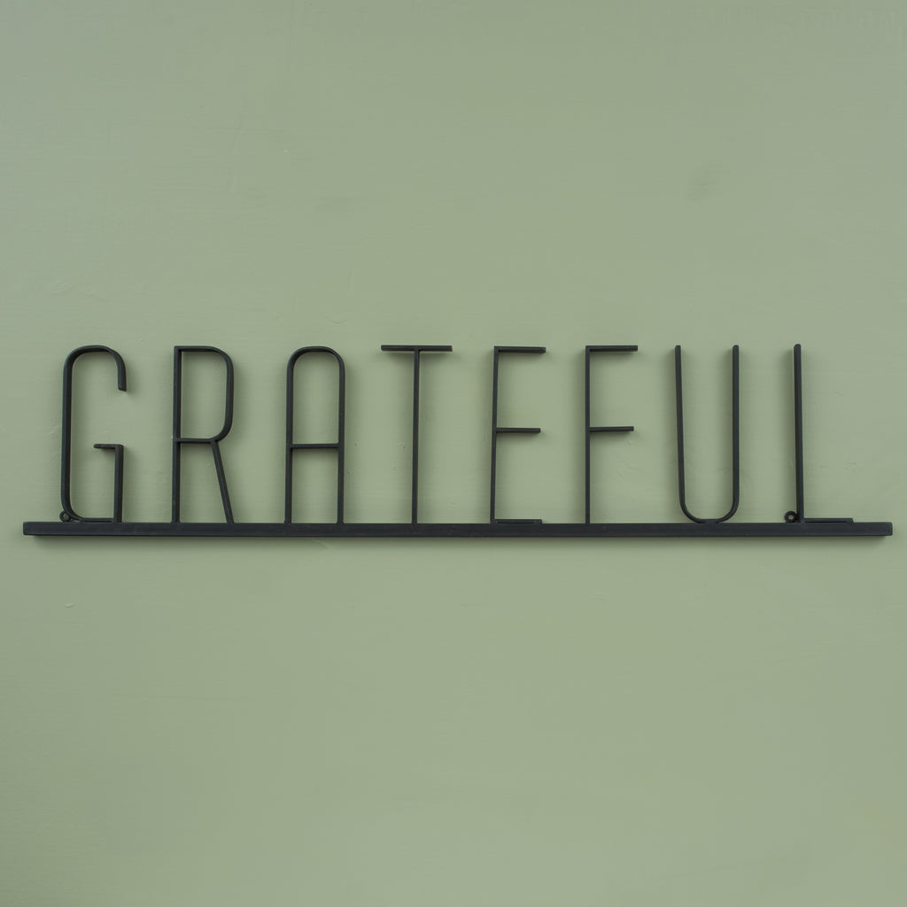 "metal sign that reads ""grateful"""