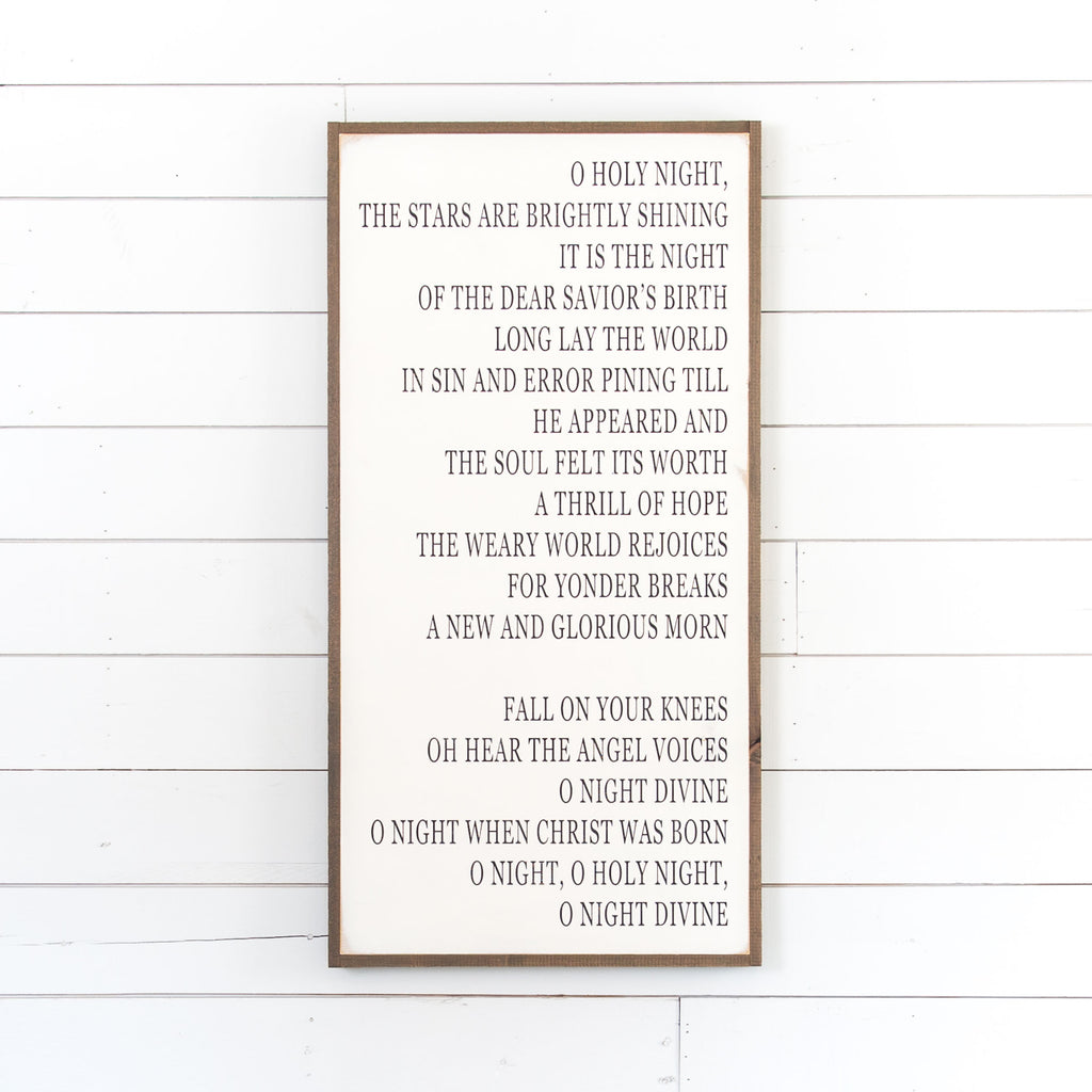 "white wooden sign with the lyrics to ""O Holy Night"""