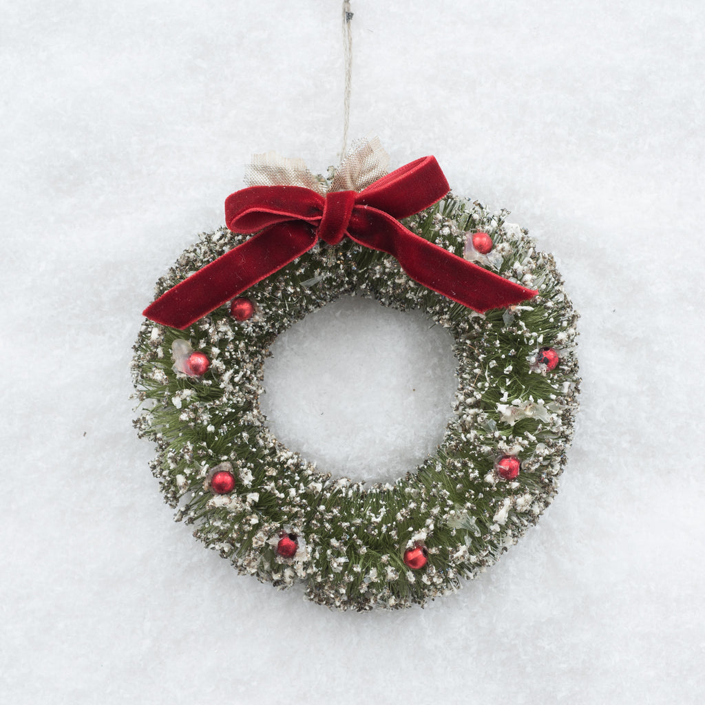 miniature wreath ornament with red bow