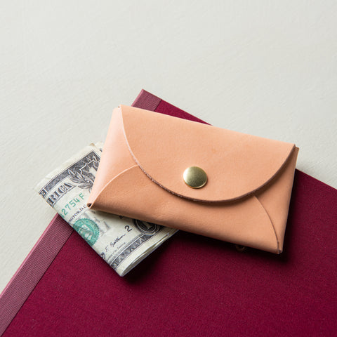 nude colored leather mini wallet with snap closure