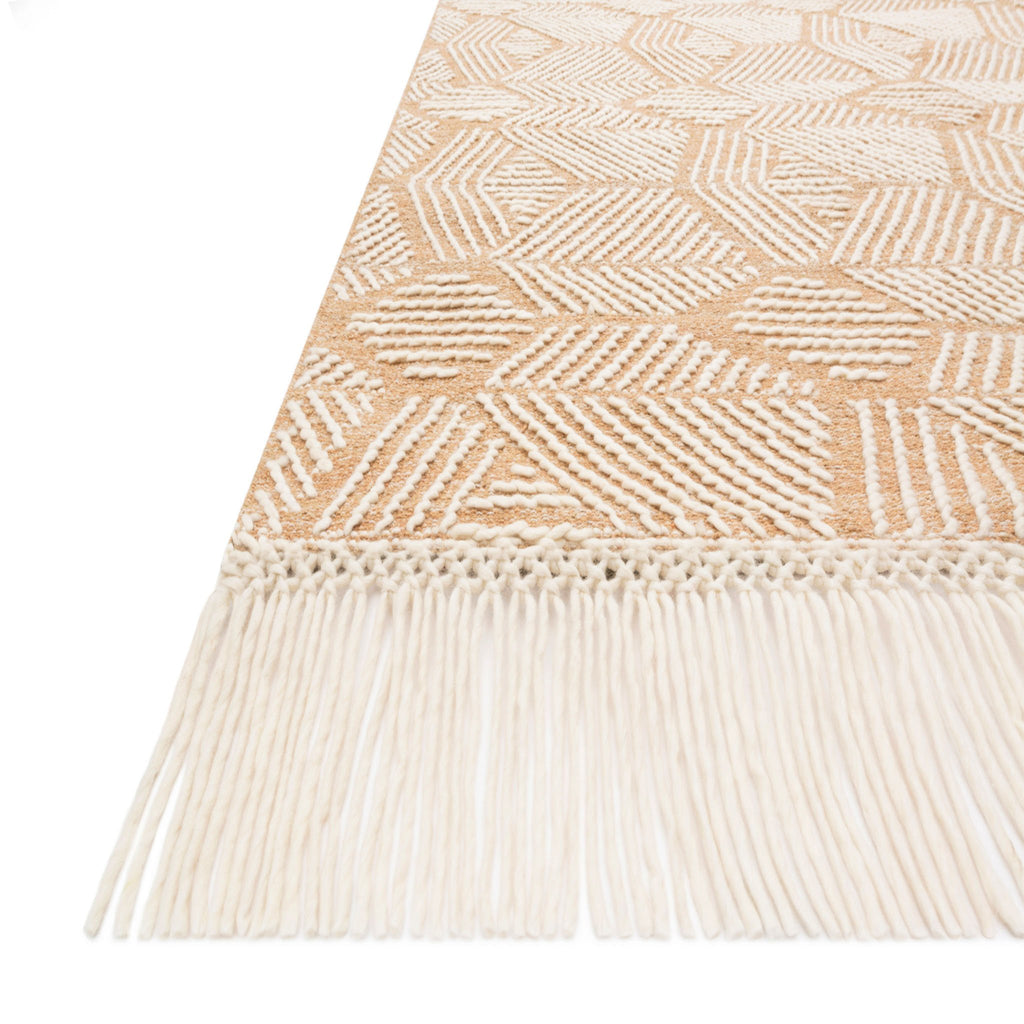 modern blush pink and cream rug with cream geometric patterns and tassel fringe