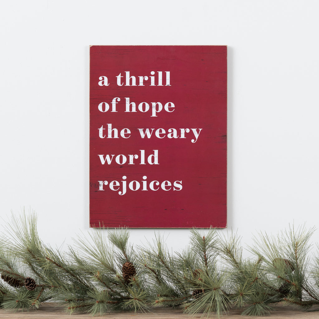 "red wooden quote sign that reads ""a thrill of hope the weary world rejoices"""