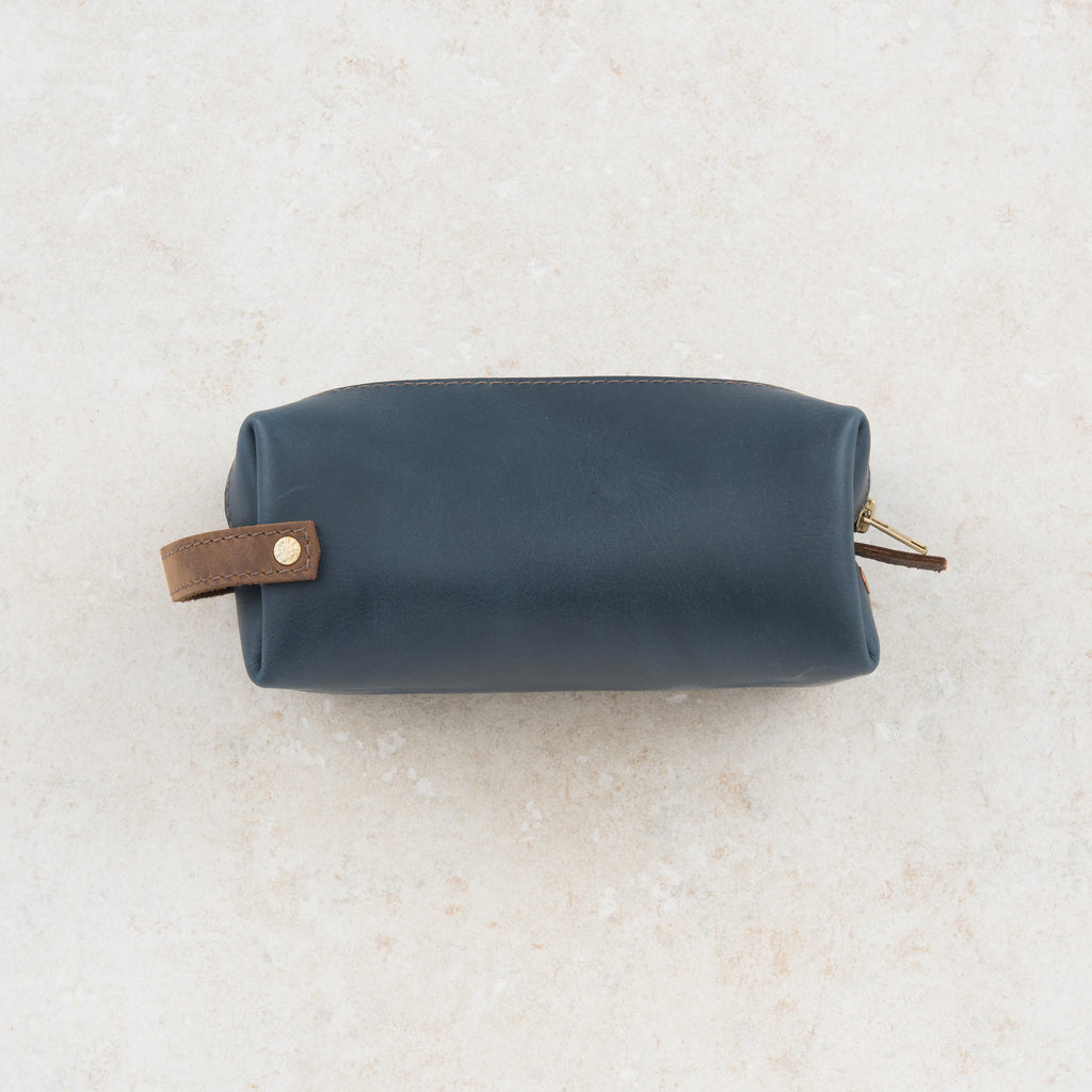 dark blue leather dopp kit