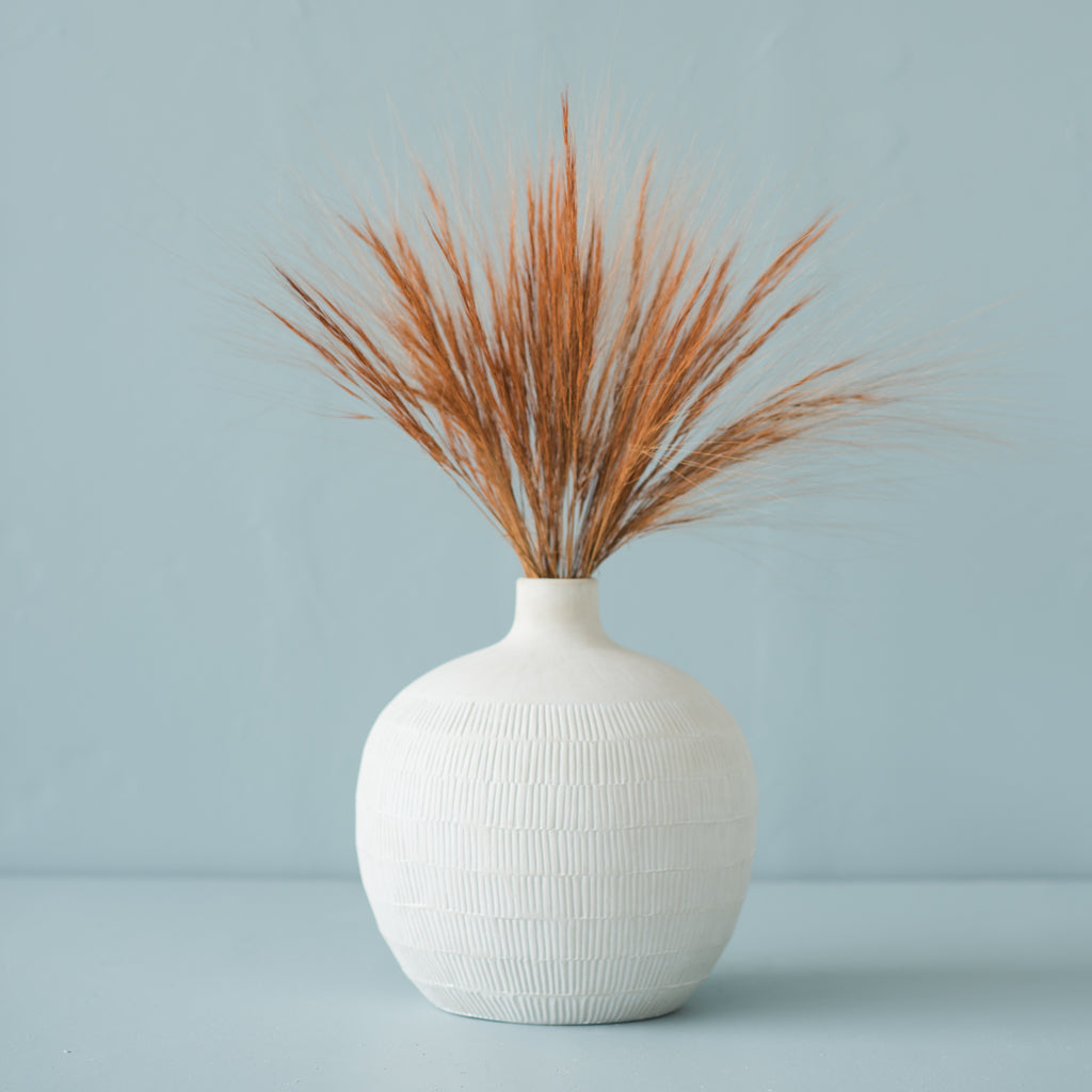 white large bulb shaped ceramic vase