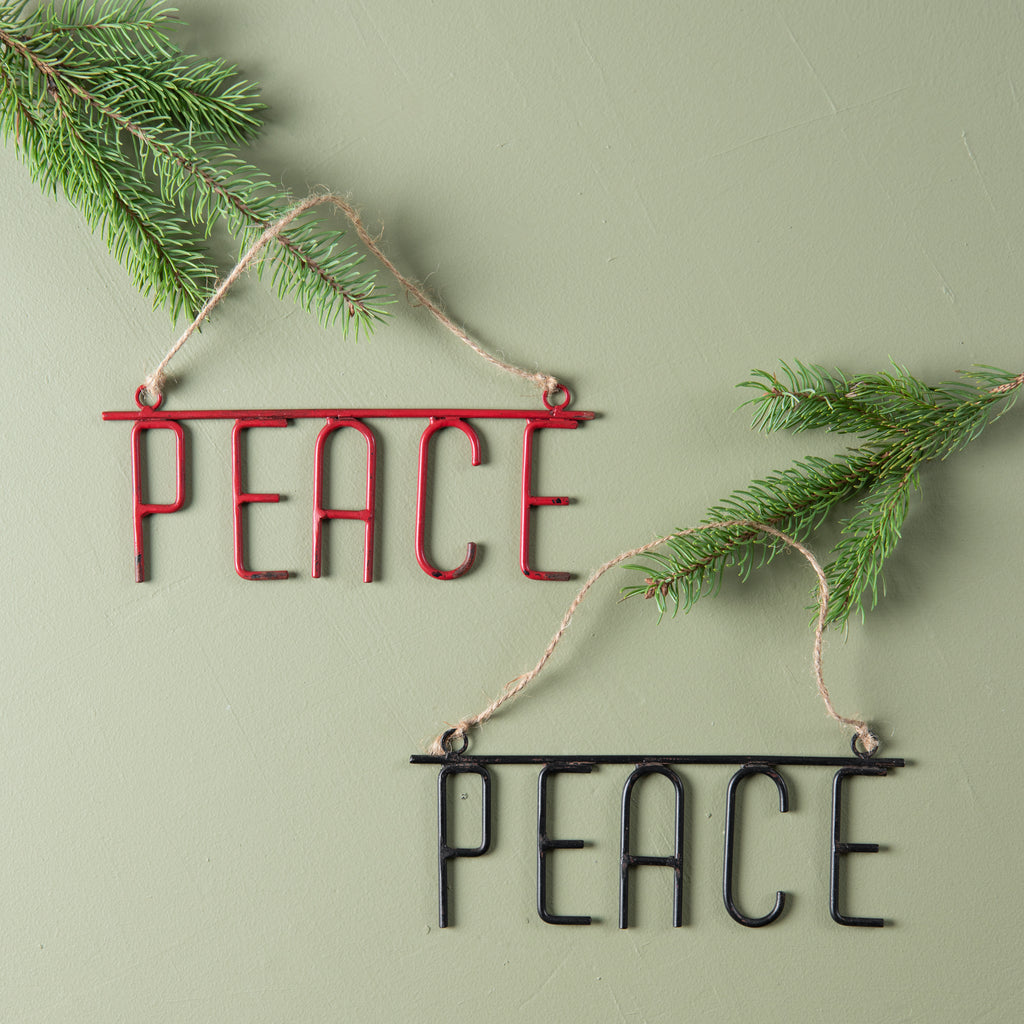 "metal ornament of the word ""PEACE"""