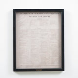 enlarged newspaper print in wood frame