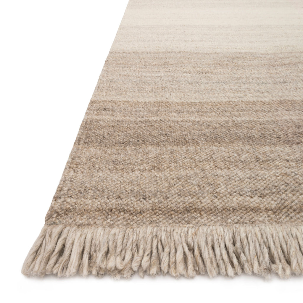modern tan and cream ombre patterned rug with tassels