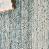 modern blue and grey ombre patterned rug with tassels