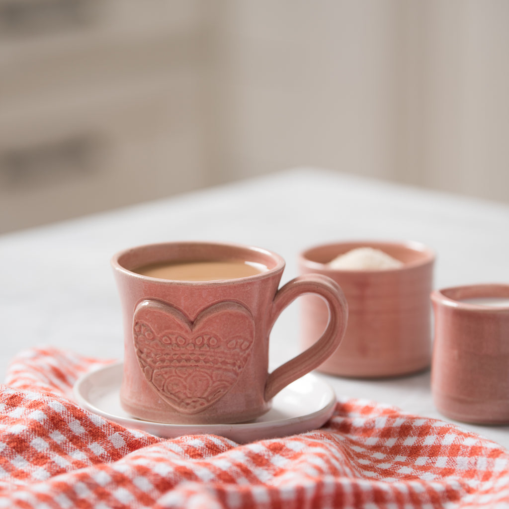 pink hand thrown valentines coffee mug with heart stamp