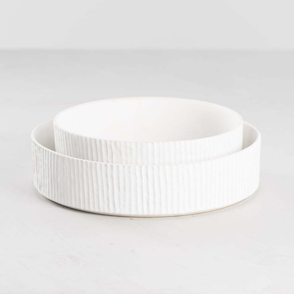 white ceramic bowl with pleated detail