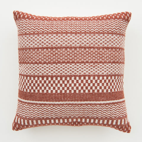 red and white striped pattern pillow with white tassels