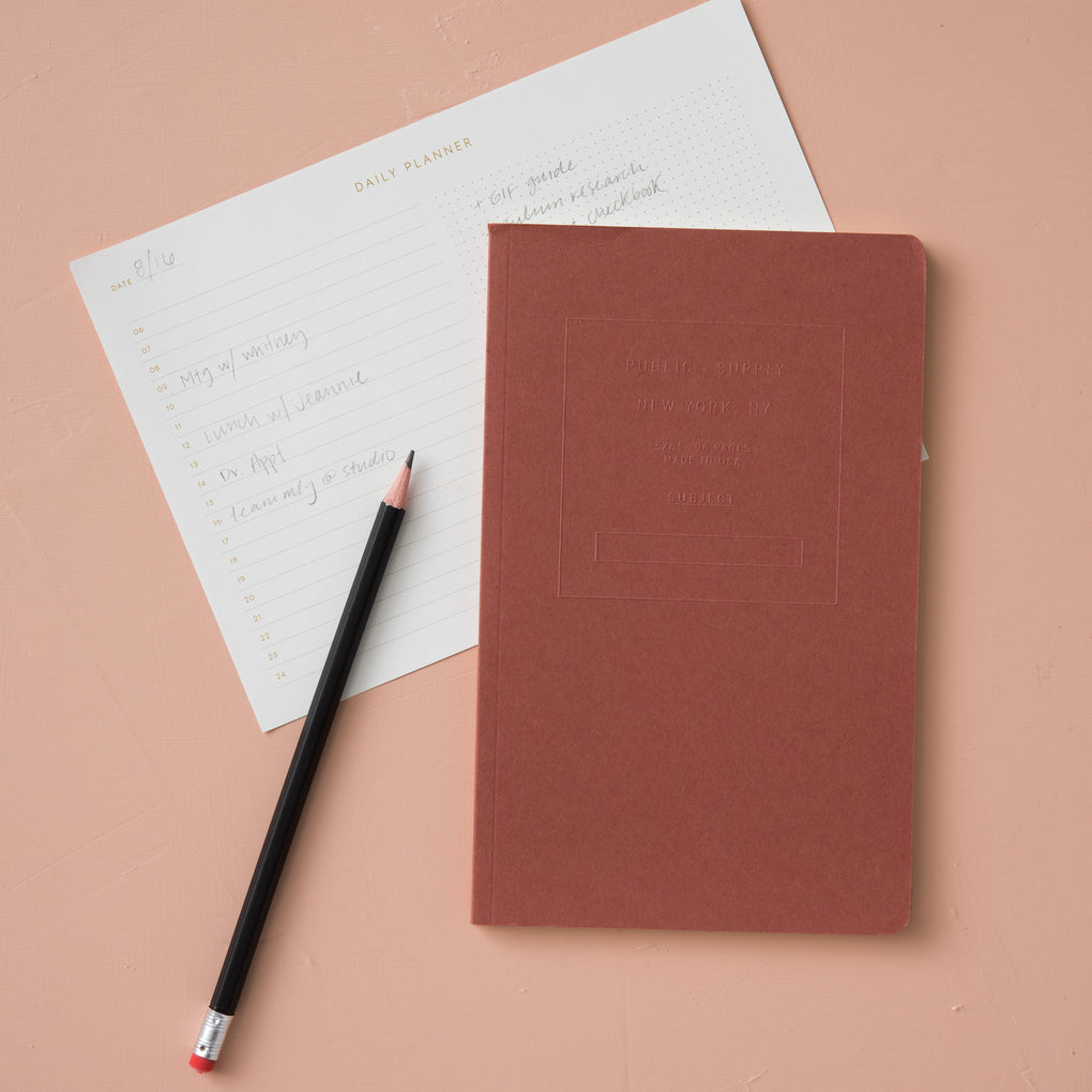 red embossed journal notebook with dot grid pages
