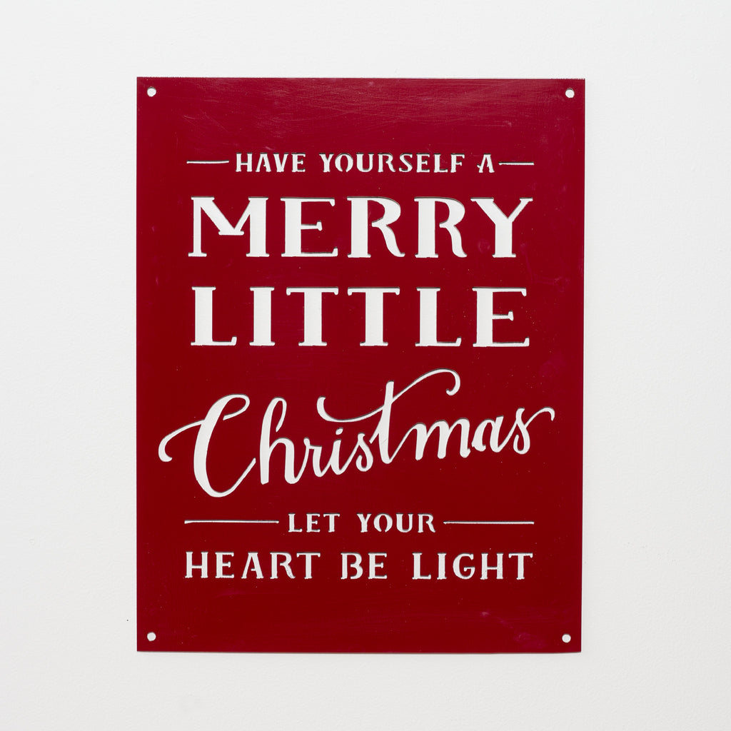 "red metal quote sign that says ""have yourself a merry little christmas"""
