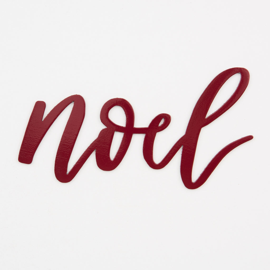 "red metal script wall sign that says ""noel"""