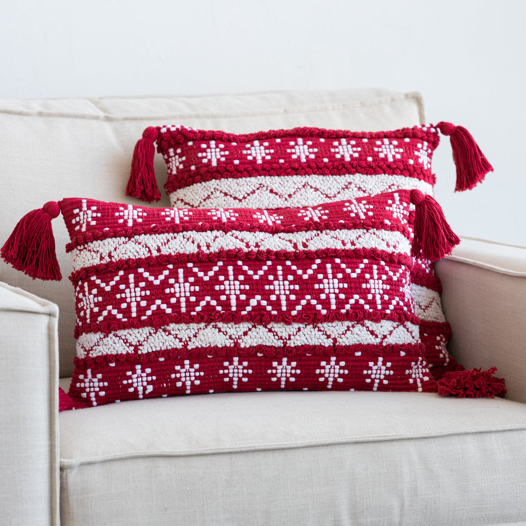 red and white striped holiday pattern pillow with red tassels