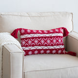 red and white striped holiday pattern lumbar pillow with red tassels