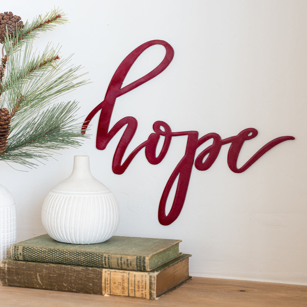 "red metal script wall expression reading ""hope"""