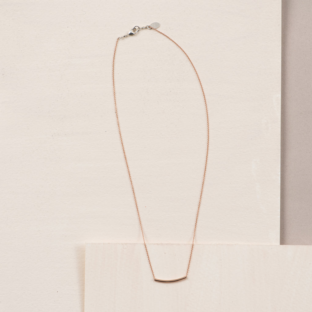 thin rose gold necklace with tube pendant
