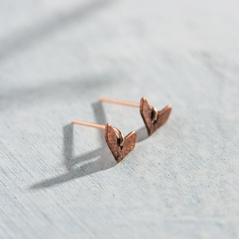rose gold fishtail shaped stud earrings