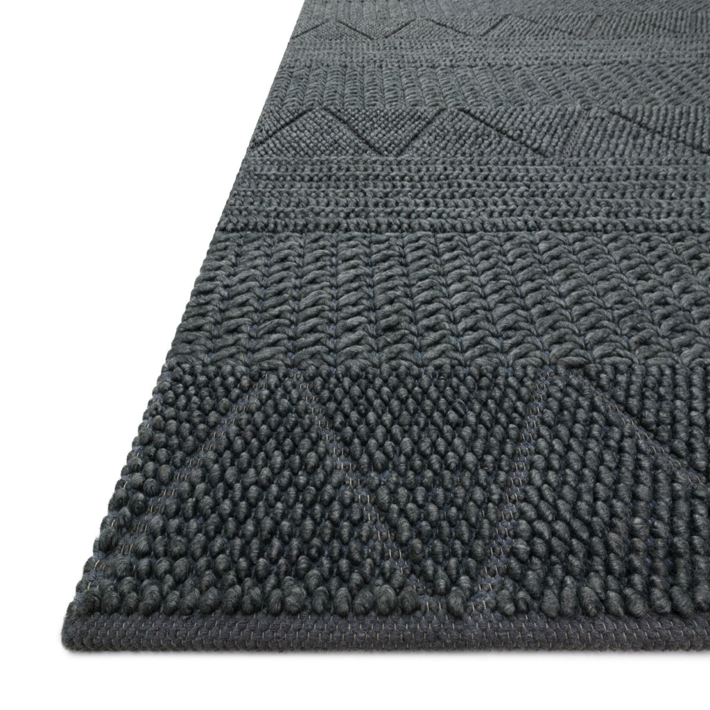 modern dark blue rug with knotted geometric patterns