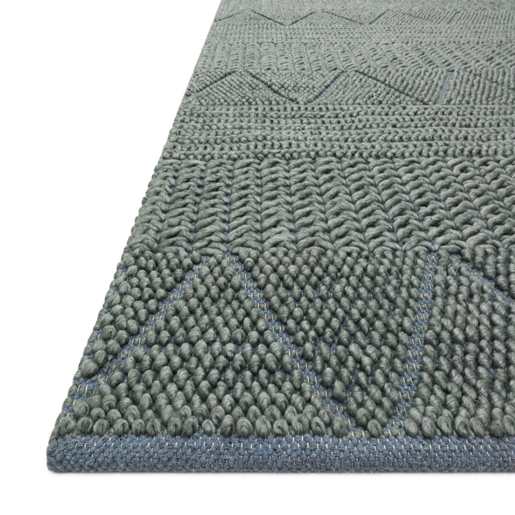 modern dark teal rug with knotted geometric patterns