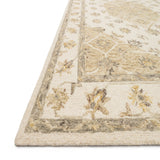 ivory and natural traditional rug with floral detail