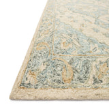 ivory and light blue traditional rug with floral detail