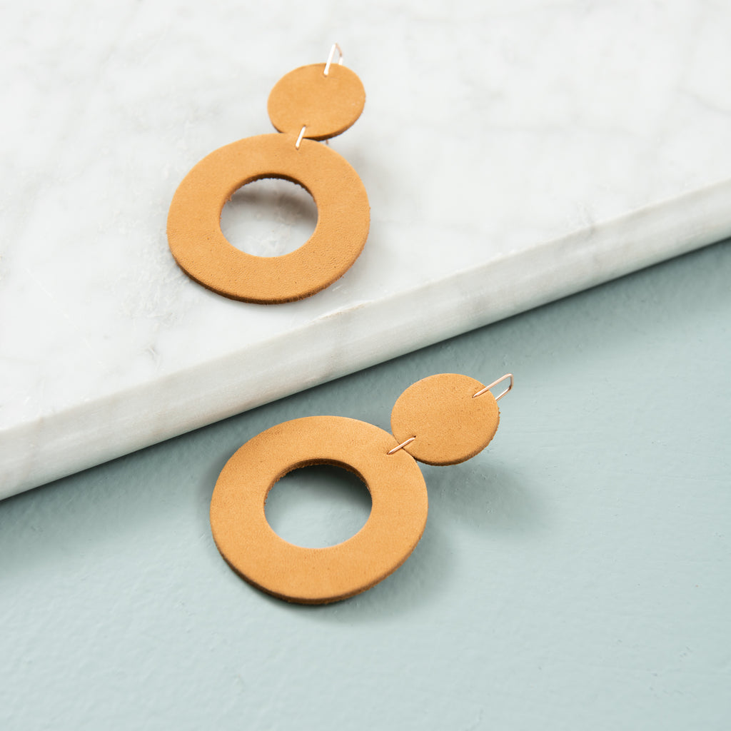 camel colored leather earrings with circle hoops