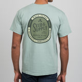 pale green Magnolia Seed & Supply shirt with front left pocket