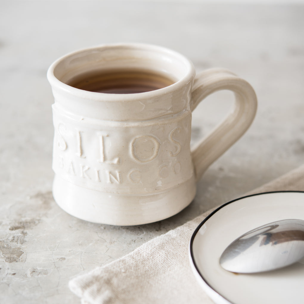 hand thrown coffee mug with silos baking co logo