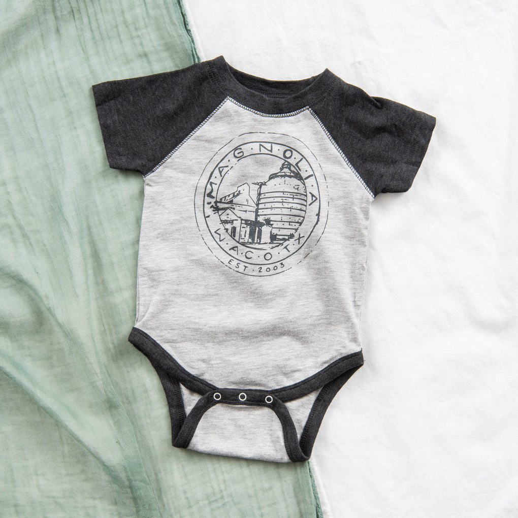 grey and black baseball tee style baby bodysuit with magnolia silos seal logo