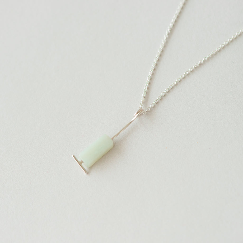 silver necklace with jade accent pendant