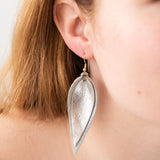 silver metallic leather layered leaf shaped earrings