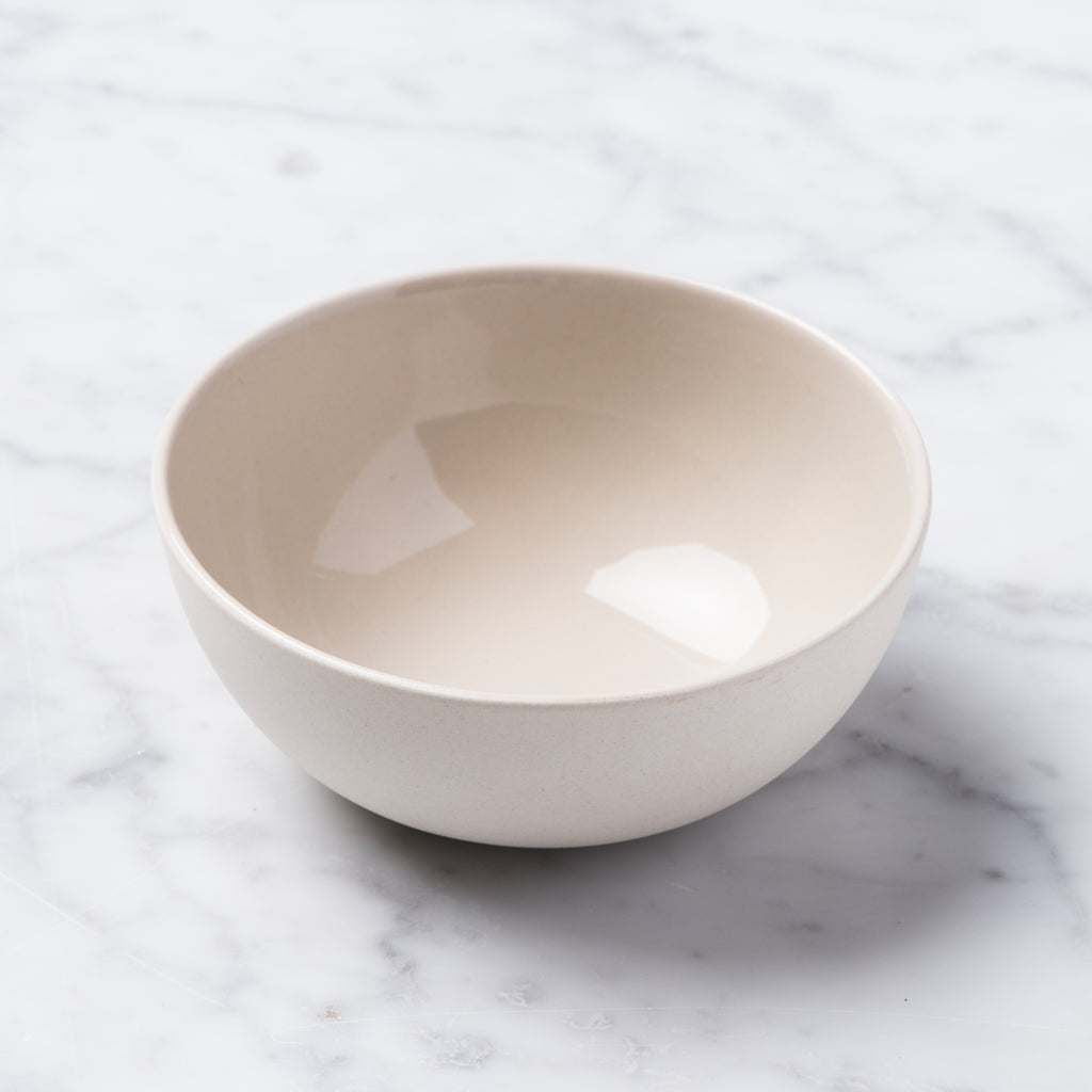 small white ceramic bisque bowl with grey interior