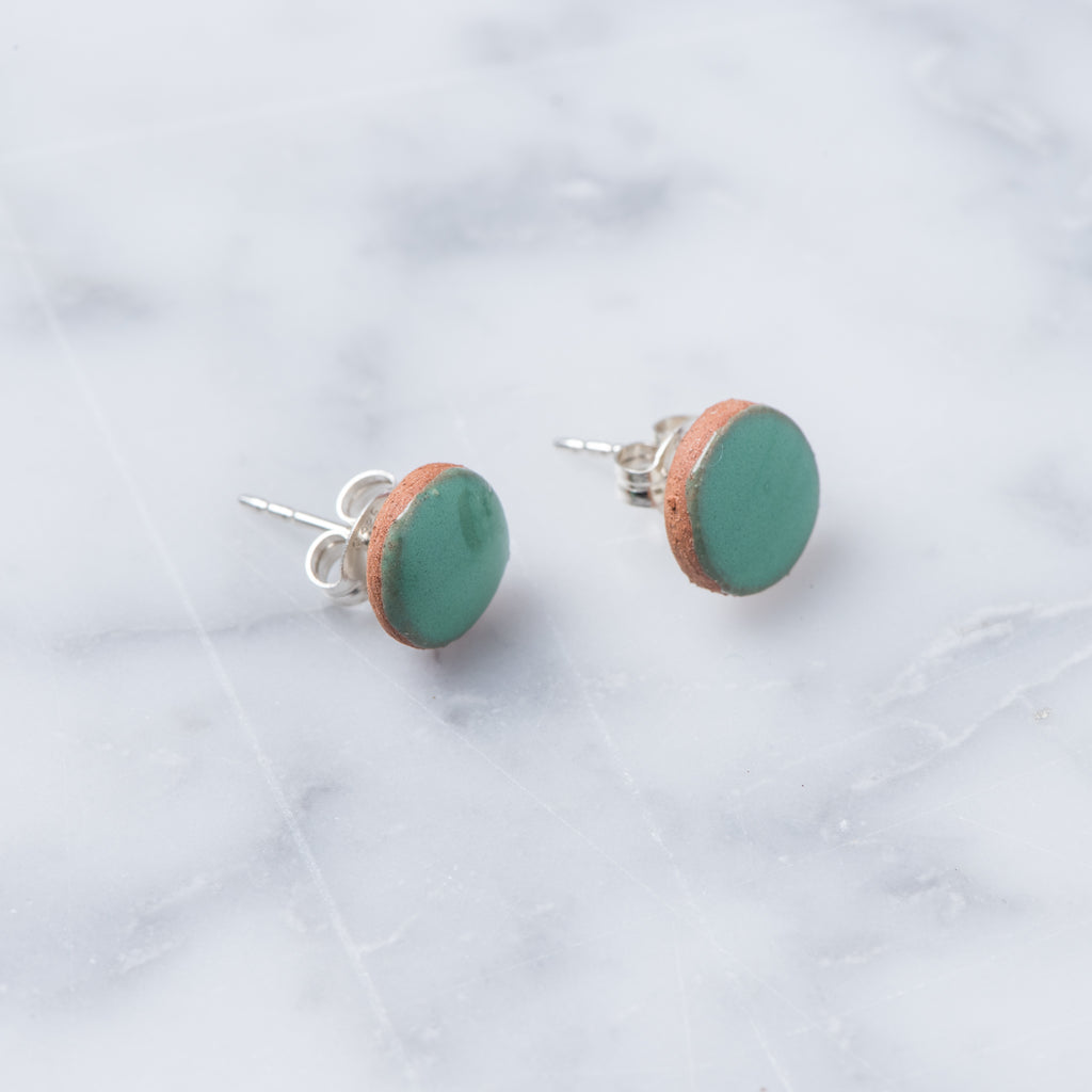 mini clay circle stud earrings dipped in green paint with sterling silver backing