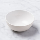 small white ceramic bisque bowl with white interior