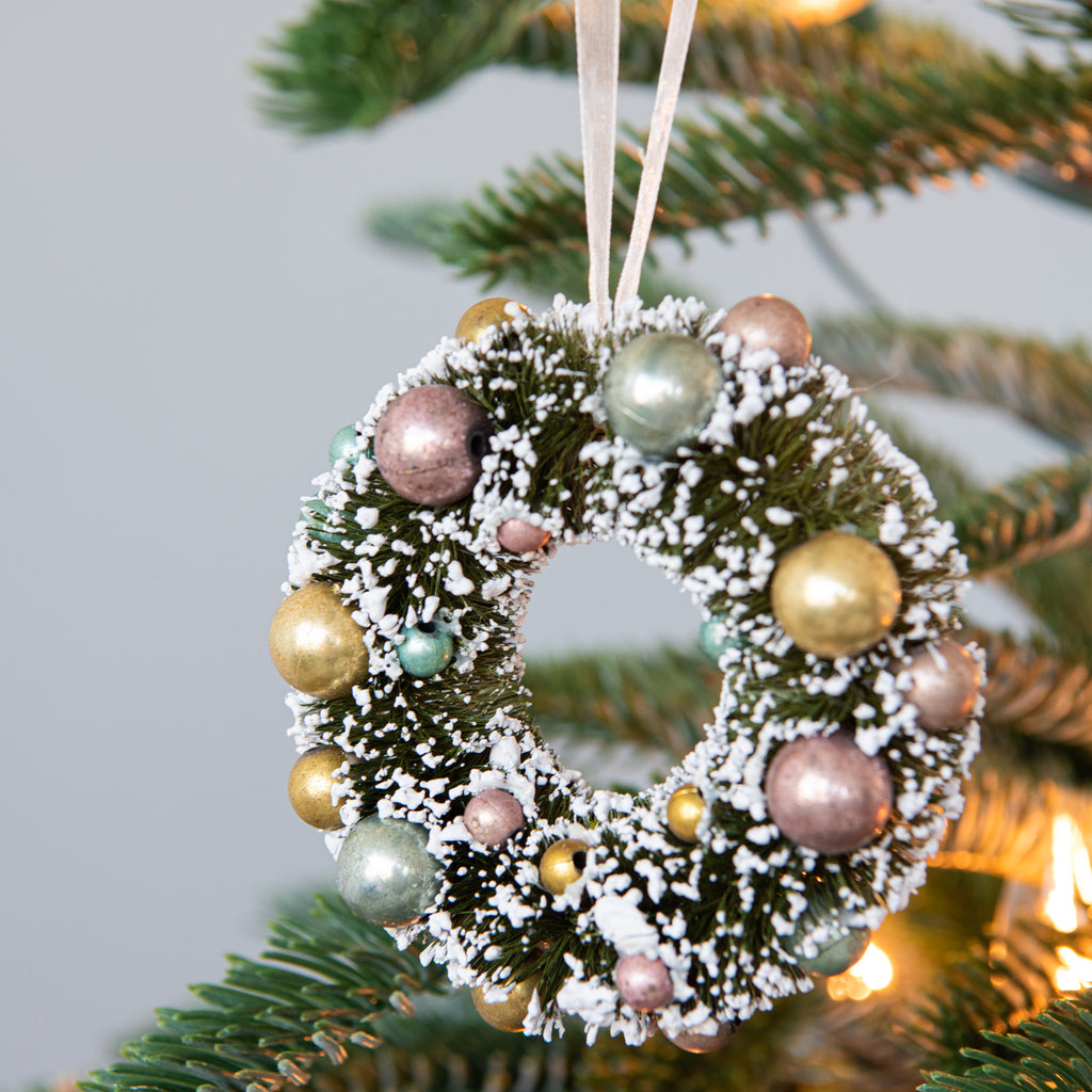 snowy wreath with tiny colorful ornaments christmas ornament