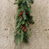 artificial spruce garland with red berries