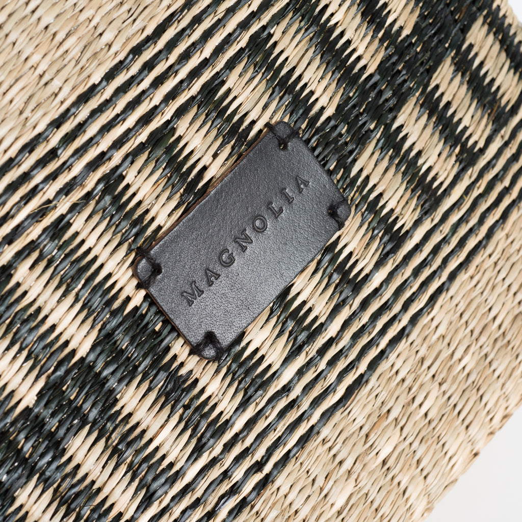 square seagrass woven basket with modern black striped detail