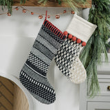 white stocking with black pattern and red pom poms