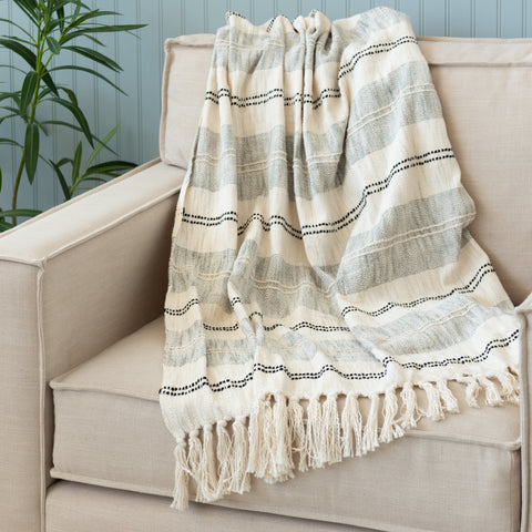 cream, light grey, and dark grey striped throw with tassel fringe