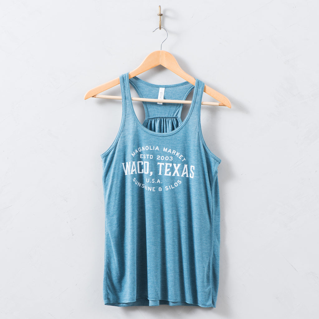 teal tank top with waco, texas sunshine and silos logo