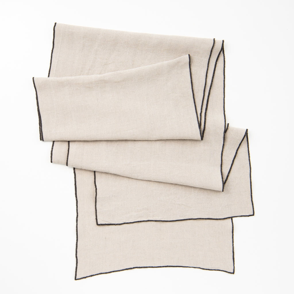 grey surged edge linen runner