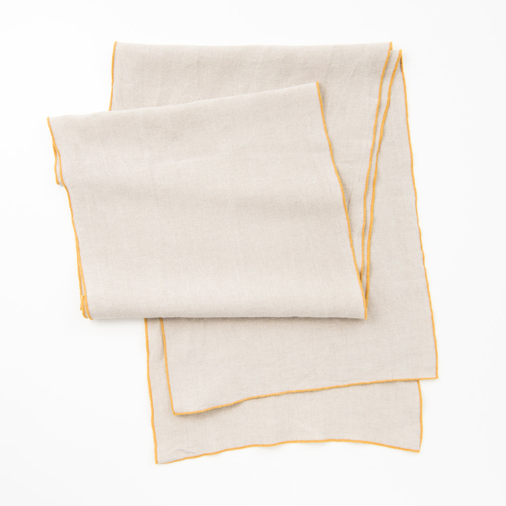 mustard surged edge linen runner