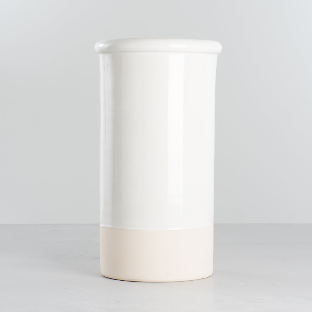 white and cream color blocked ceramic vase