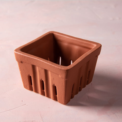 terracotta colored ceramic berry basket