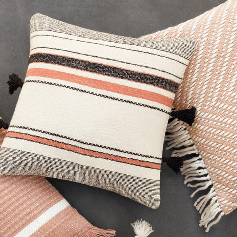 grey, terracotta, and cream striped modern pillow with black tassels